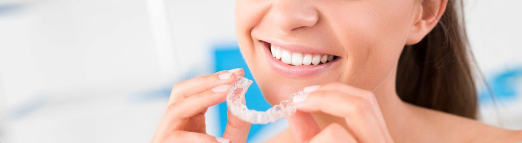 Woman with clear aligner
