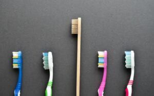 A bamboo toothbrush amongst plastic